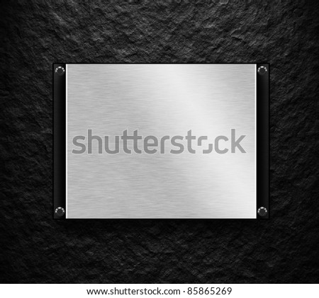 black wall with metal plate