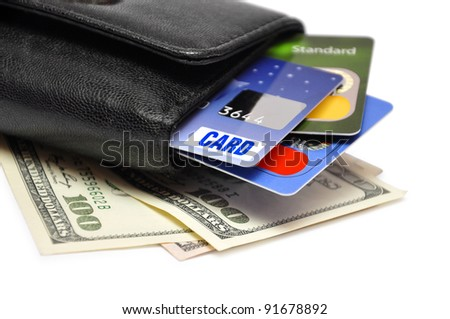 Black Wallet with credit cards and dollar banknotes over white background - stock photo