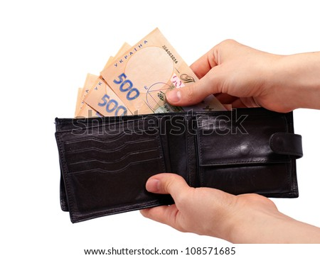 Black wallet with ukrainian money in hands isolated on white background