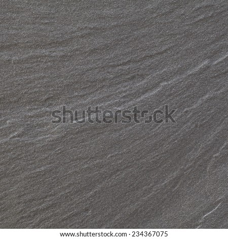 Black warm limestone rock texture and background   - stock photo