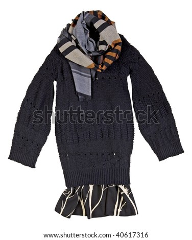 black warm winter knitted wool long sweater with a large color checkered scarf and a skirt - stock photo
