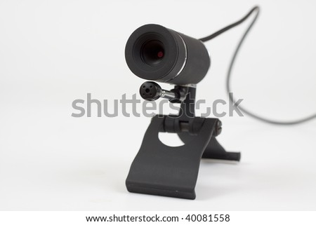 black webcam with microphone on white background