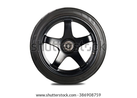 Black wheel with tires isolated on white background - stock photo