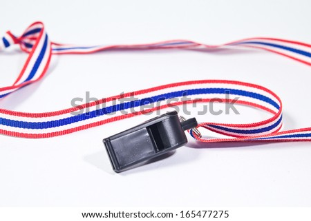 black whistle with Thailand national flag lanyard on white background - stock photo