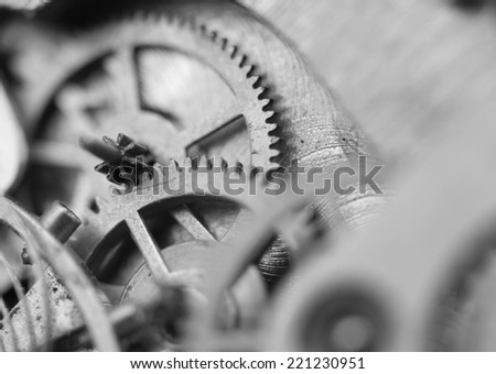 Black white background with metal cogwheels a clockwork. Conceptual photo for your successful business design. Macro.   - stock photo