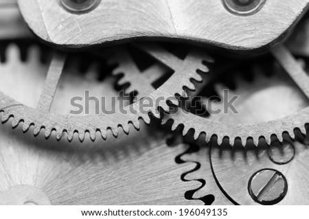 Black white background with metal cogwheels a clockwork. Macro - stock photo