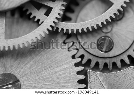 Black white background with metal cogwheels a clockwork. Macro - stock photo