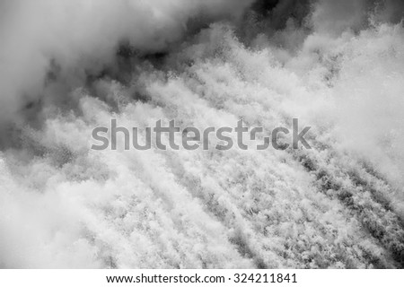 Black&white Close up on Spillway on hydroelectric water power dam background - stock photo