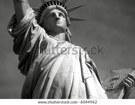 Black & white close up view of Statue of Liberty and her tablet on Liberty Island in New York City. - stock photo