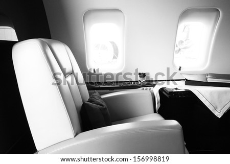 black white corporate Business Jet Interior with leather chair - stock photo
