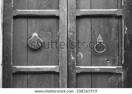 black & white door detail with a shell and handle - stock photo