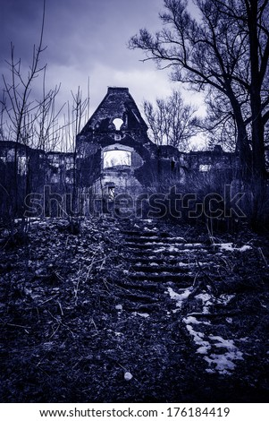 black white horror landscape ruined building trees stairs toned blue - stock photo