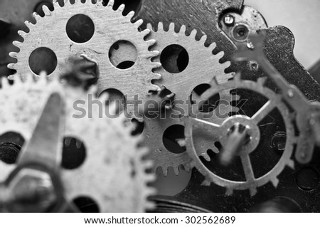 Black white Metal Cogwheels Inside Old Clockwork to success concept for your technology design. Macro - stock photo