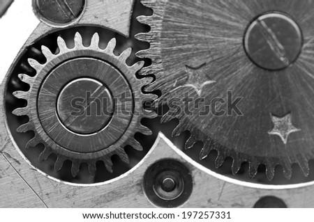 Black white Metallic Background with metal cogwheels a clockwork. Macro  - stock photo