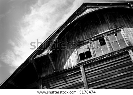 black & white of an abandoned railroad station - stock photo