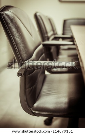 black & white of empty boardroom or meeting room. - stock photo