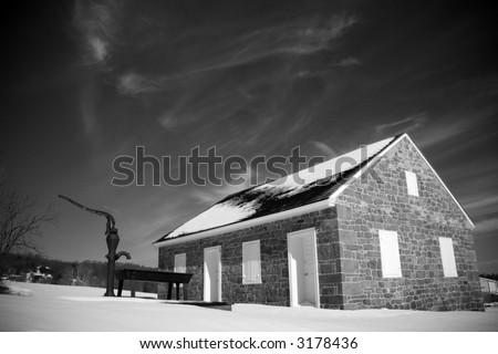 black & white photograph of an 18th century schoolhouse - stock photo