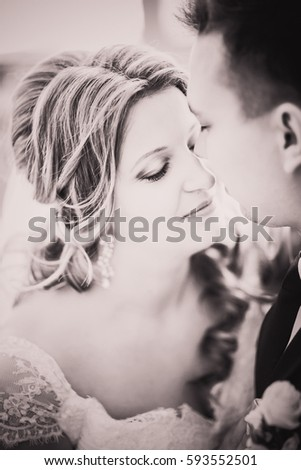 Black white photography bride and groom posing  in a hotel room
