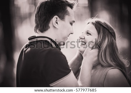 Black white photography romantic young couple  laugh on background summer forest