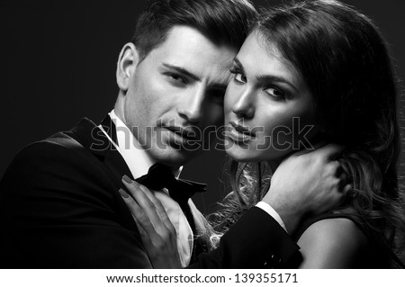Black white portrait of a sexy couple - stock photo