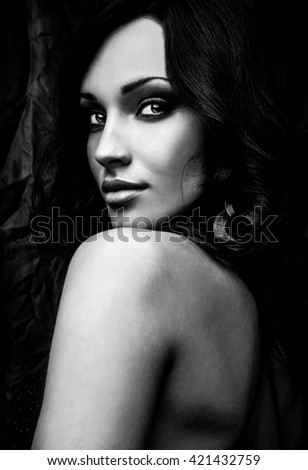 Black-white portrait of beautiful brunette woman. - stock photo