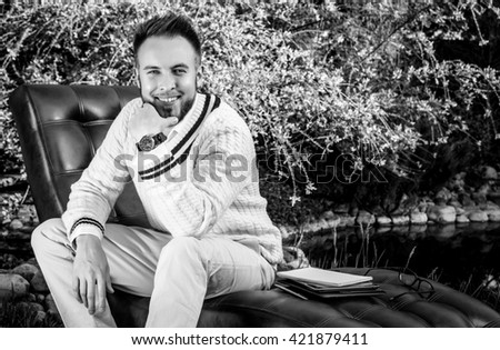 Black-white portrait of beautiful young man outdoor. - stock photo
