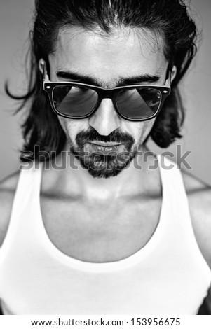 black - white portrait of man in sunglasses - stock photo