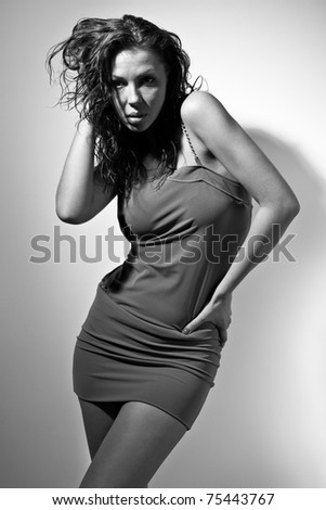 Black & white portrait of seductive young woman in short dress