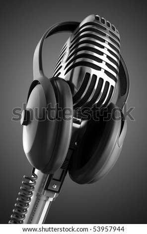 Black & White 50's microphone with headphones & clipping path included for those who need a different background. - stock photo