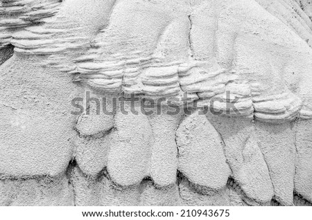 Black & white uniquely shaped sedimentary soil caused by water erosion - stock photo