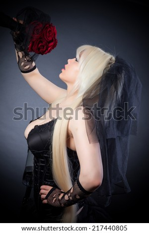 black widow in grief  with flowers  with a veil on a black background