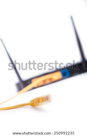 black wifi router with lan cable isolated on a white - stock photo