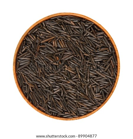 black, wild rice in a wooden bowl, in isolation, white background
