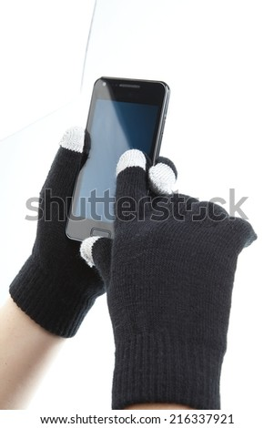 black winter glowes gloves and phone - stock photo