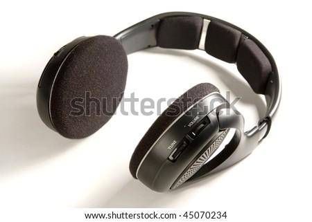 Black Wireless headphones on white ground - stock photo