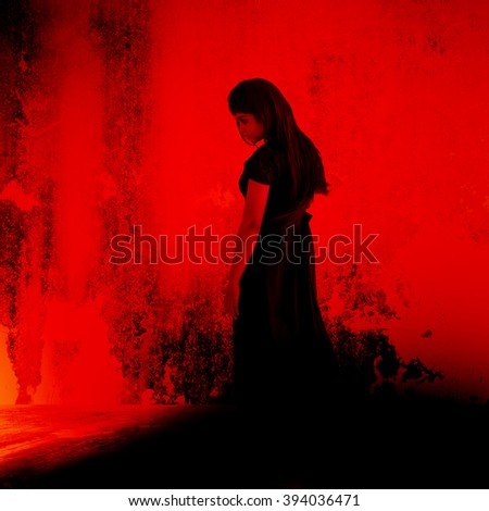 Black witch,Mysterious girl in black dress standing in abandon place,Horror background for halloween concept and movie poster project - stock photo