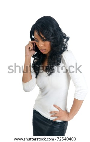 Black Woman concerned on the phone - stock photo