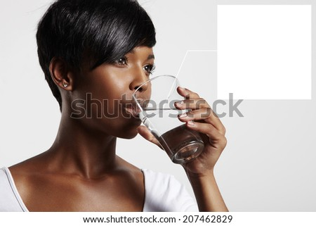 black woman drinking water. note to a water in glass   - stock photo