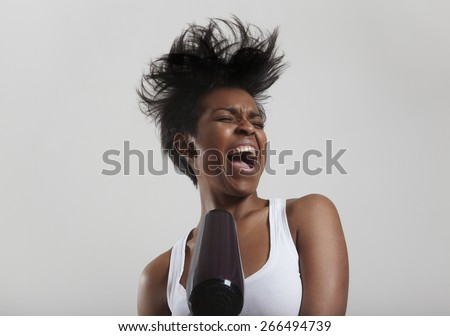 black woman drying hair and singing - stock photo