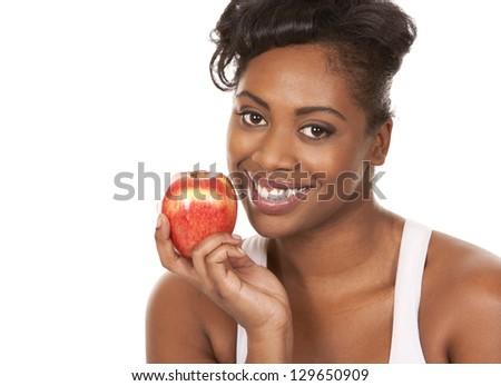 black woman holding apple on white background - stock photo