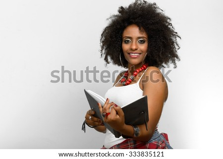 Black woman holding book