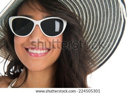 Black woman in bikini with straw summer hat and sunglasses isolated over white background - stock photo