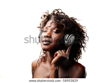 Black woman listening to music - stock photo