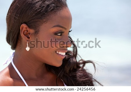 Black woman profile portrait outdoors on the beach