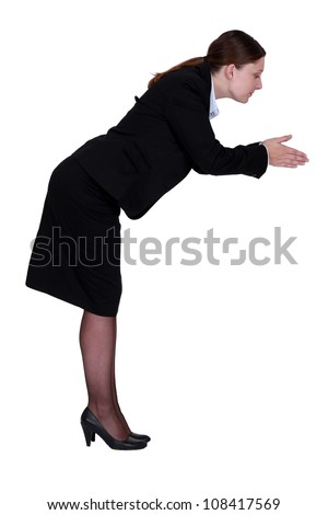 Black woman stood in a position to dive - stock photo