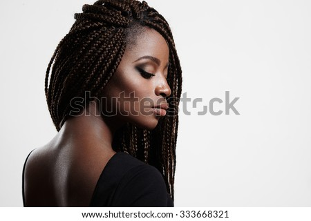 black woman with braids and evening smokey eyes - stock photo