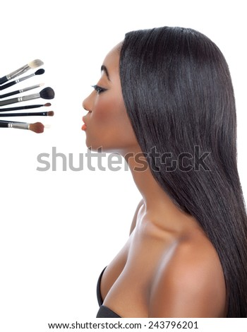 Black woman with straight hair and makeup brushes isolated on white - stock photo