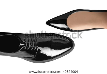 black women's and men's shoes on white - stock photo