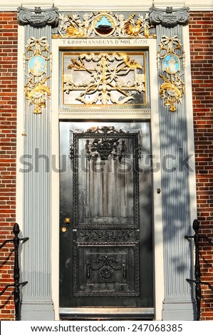 Black wooden door of the old red brick building of renaissance style (the 18 century). Holland, Europe. Architectural theme.