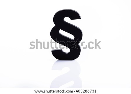 Black wooden paragraph the symbol of law - isolated on white background. Law concept - stock photo